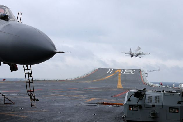 J-15 fighters from China's Liaoning aircraft carrier conduct a drill in an area of South China Sea, January...