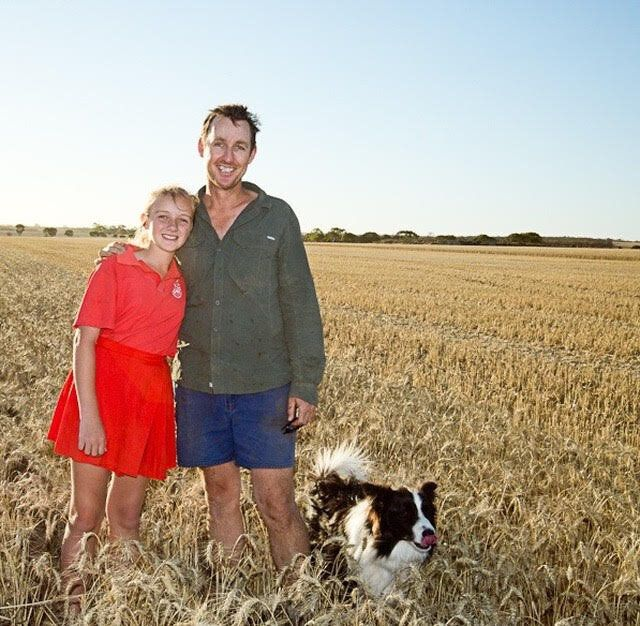 Farmer Bob Nixon with daughter Isabelle and Jimmy the legendary farm dog.