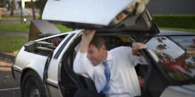 Mike Baird hops out of a Delorean on 'Back To The Future Day'