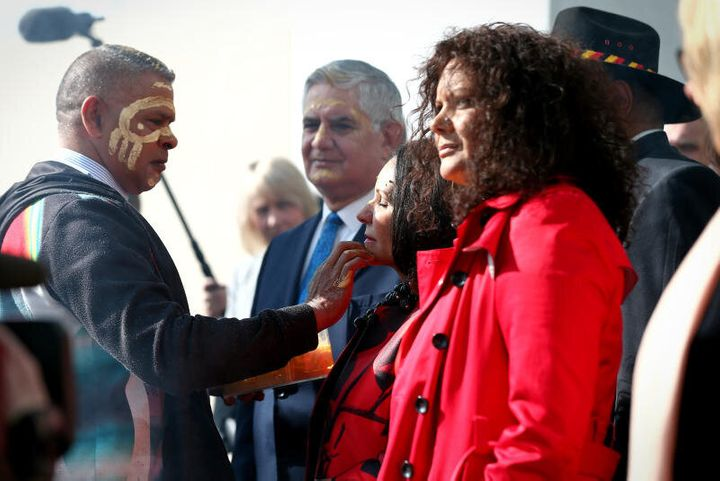 Ken Wyatt, Linda Burney and Malarndirri McCarthy during the smoking ceremony at the welcome to country on of the 45th Parliament