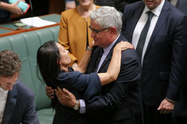 Ken Wyatt embraces Linda Burney, first Aboriginal woman in the House of Representatives, after she delivered her maiden speech