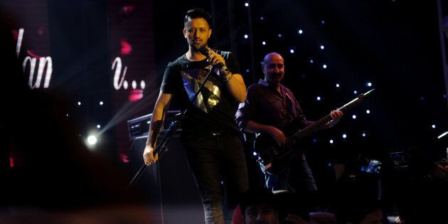 DHAKA, BANGLADESH - MAY 30: Celebrated Pakistani playback singer Atif Aslam performs at 'Rhythm for All with Atif Aslam Night Live in Dhaka' at the Navratri Hall of International Convention City Bashundhara on MaY 30, 2016 in Dhaka, Bangladesh. Atif Aslam is a Pakistani singer and film actor. His debut movie was the 2010 social drama Bol - one of the highest-grossing Pakistani films of all time. (Photo by Sk Hasan Ali/Corbis via Getty Images)