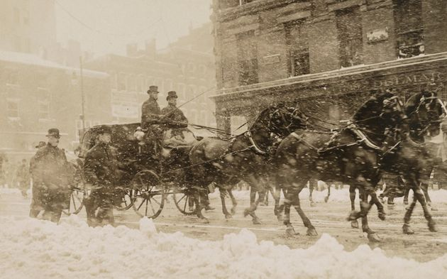 William Howard Taft and President Theodore Roosevelt head through a snowstorm to the Capitol for Taft's...