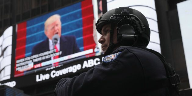 A policeman stands guard during the televised inauguration of Donald Trump as the 45th president of the United States, Jan. 20, 2017, in New York City.
