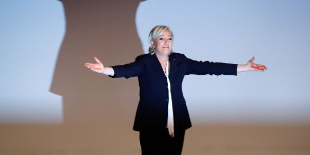 France's National Front leader Marine Le Pen gestures after her speech during a European far-right leaders meeting to discuss about the European Union, in Koblenz, Germany, January 21, 2017.