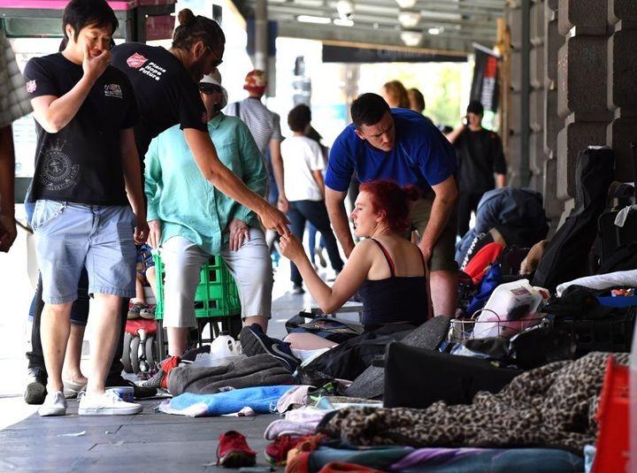 Homeless people camp along Flinders Street on January 18, 2017.