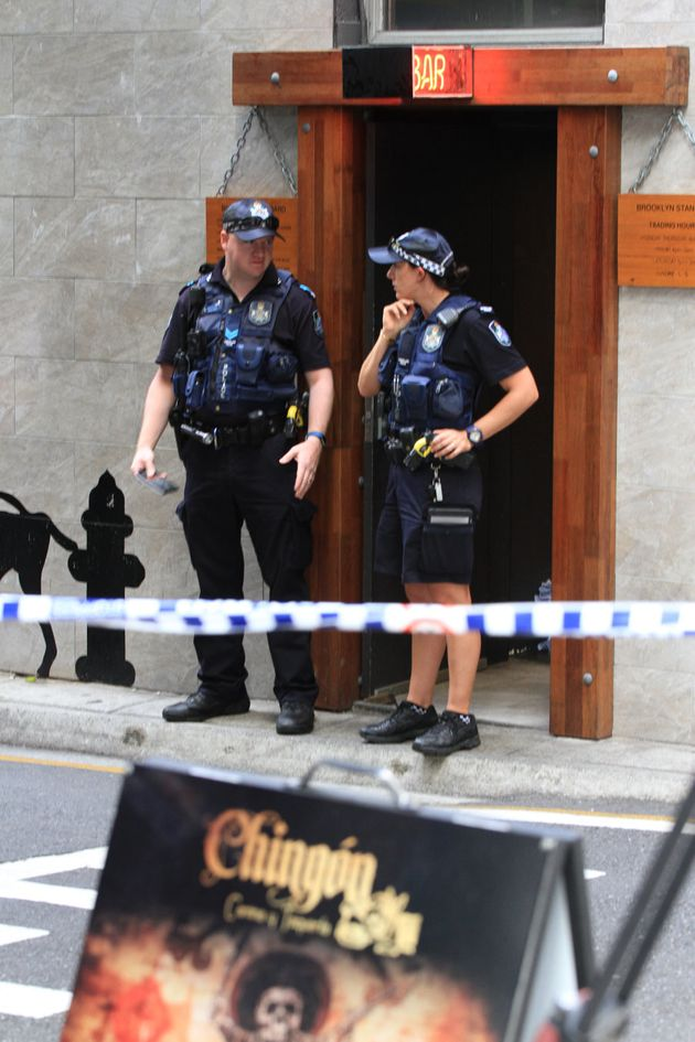 Police stand near the scene of a fatal shooting on a Brisbane film