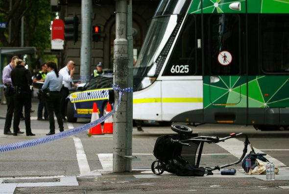 A pram is seen as police cordon off Bourke Street mall, after a car hit pedestrians in central