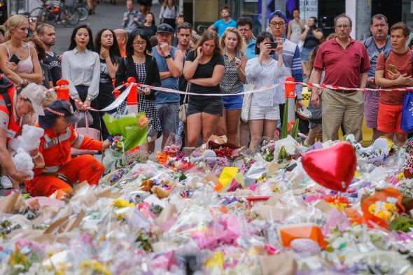 People pay their respects at at Bourke St Mall in Melbourne