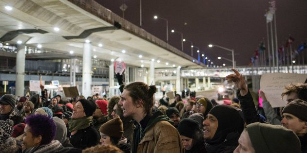 Thousands fill the street outside Terminal 5 of O'Hare International Airport in Chicago in protest of...