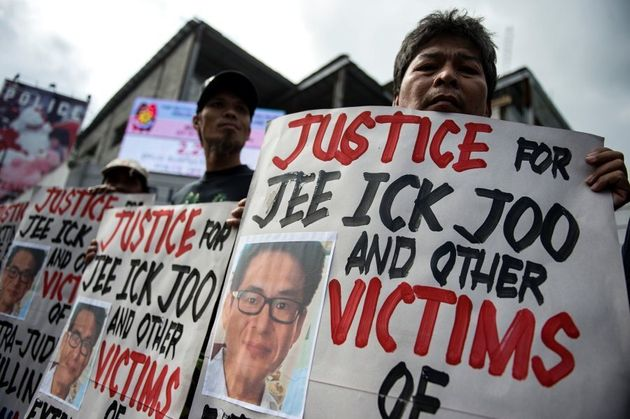 Activists hold a protest at the spot where Jee Ick Joo was