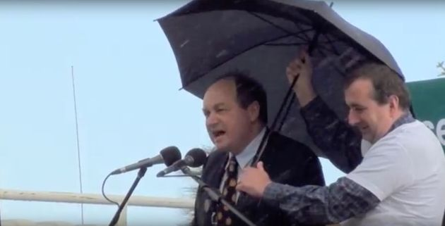 David Archibald gives a speech in the rain in