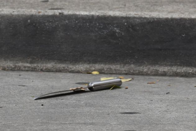 Another knife can be seen on the ground where police have established a crime