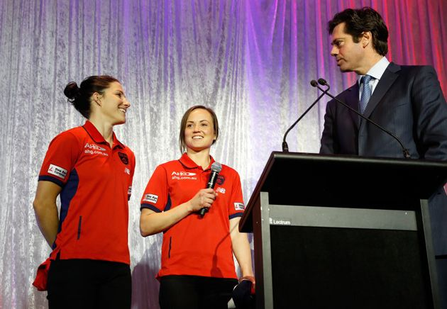 Melissa Hickey (left) and Daisy Pearce of the Demons chat with Gillon McLachlan during the Women's League...