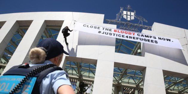 The banner unfurled from the top of Parliament House last