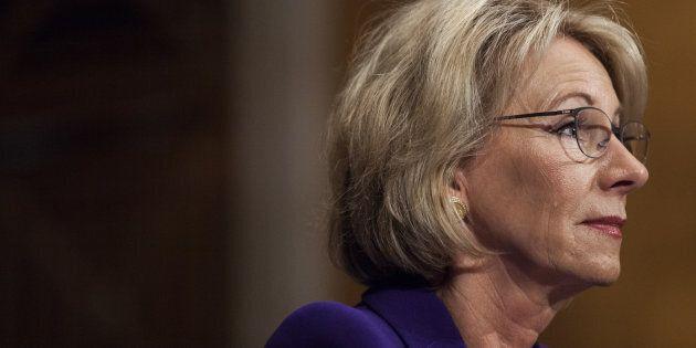Betsy DeVos, secretary of education nominee for U.S. President-elect Donald Trump, listens during a Senate...