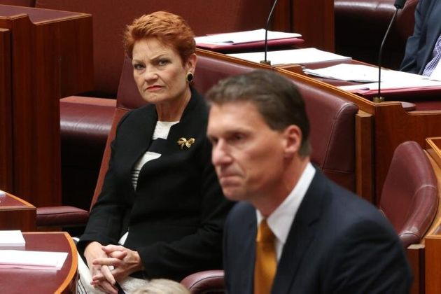 Pauline Hanson listening to Cory Bernardi announce his departure from the Liberal