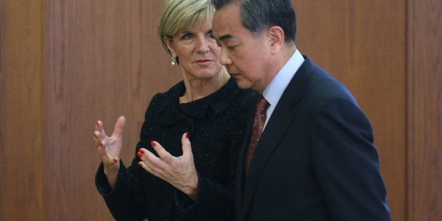 Chinese Foreign Minister Wang Yi (R) and Australian Foreign Minister Julie Bishop talk after a joint...