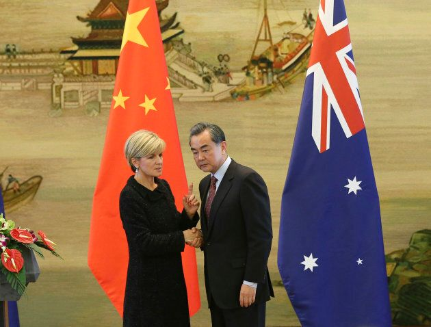 Australian Foreign Minister Julie Bishop pictured here shaking hands with Chinese Foreign Minister Wang...