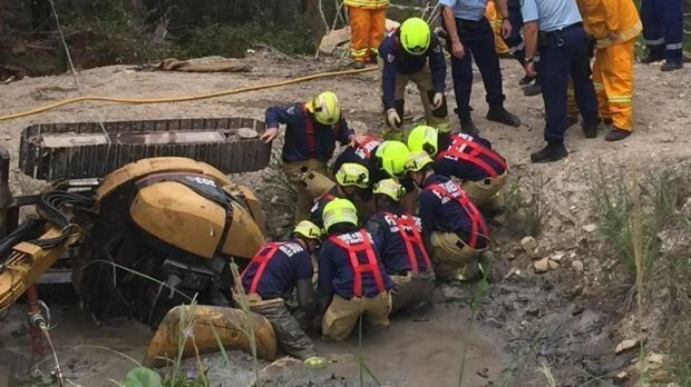 The rescue workers had to dig beneath Miller's body in a bid to slide him out from the excavator's roll