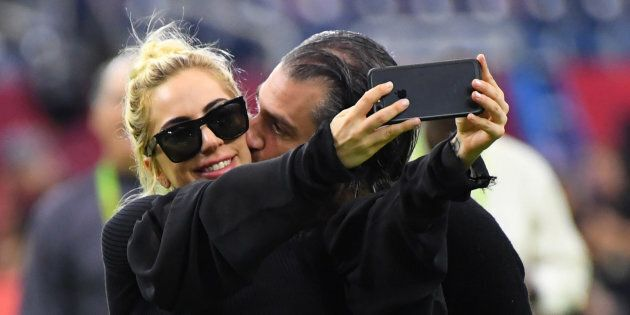 Lady Gaga gets a kiss from Christian Carino before Super Bowl LI.