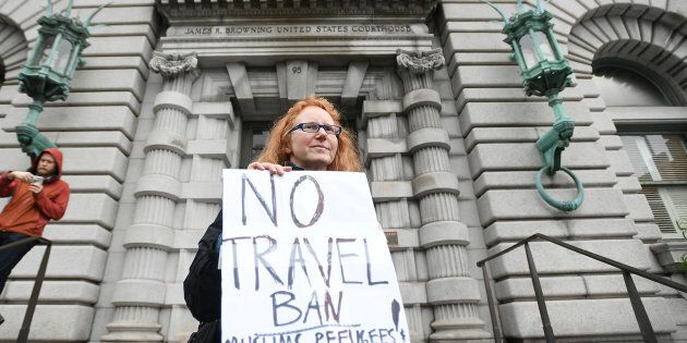 Beth Kohn protests outside the 9th U.S. Circuit Court of Appeals courthouse in San Francisco, California February 7, 2017, while the Court hears arguments regarding President Donald Trump's temporary travel ban on people from seven Muslim-majority countries. REUTERS/Noah Berger