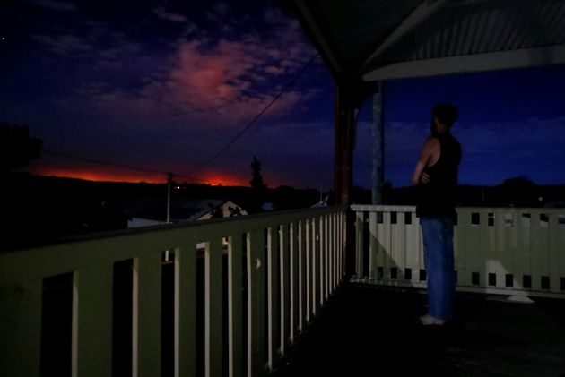 Evacuated resident Nathan Blatch from Uarby views the glow of the Sir Ivan fire east of Dunedoo, NSW,...