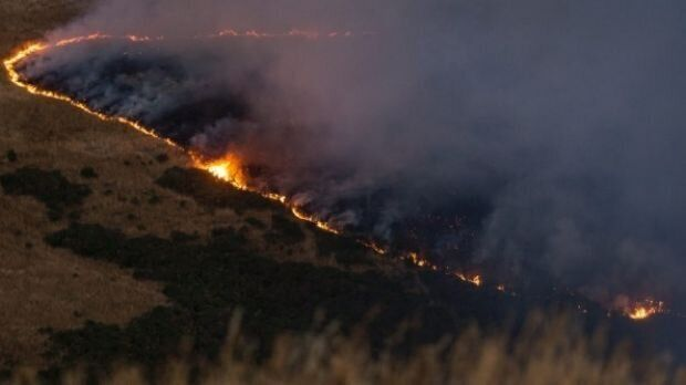 A line of fire burns across Port Hills, south of