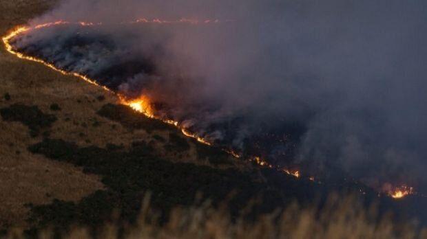A line of fire burns across Port Hills, south of Christchurch