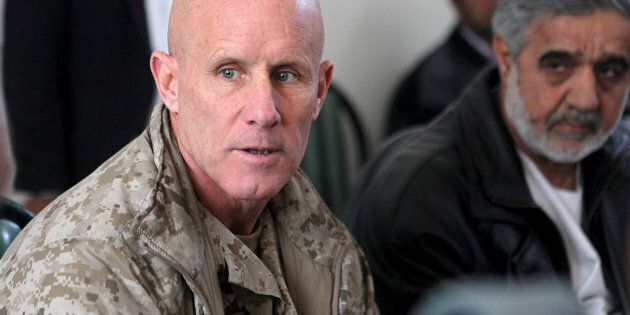 Vice Adm. Robert S. Harward, commanding officer of Combined Joint Interagency Task Force 435, speaks to an Afghan official during his visit to Zaranj, Afghanistan, in this January 6, 2011 handout photo. The visit consisted of a tour of a provincial prison, the Iran/Afghanistan border crossing and an airfield assessment.  Sgt. Shawn Coolman/U.S. Marines/Handout via REUTERS  ATTENTION EDITORS - THIS IMAGE WAS PROVIDED BY A THIRD PARTY. EDITORIAL USE ONLY