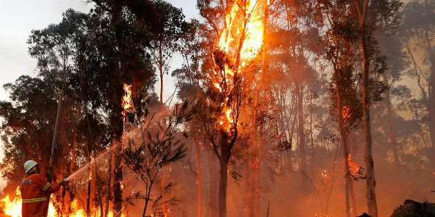 Conditions have eased in NSW where firefighters are trying to contain a devastating