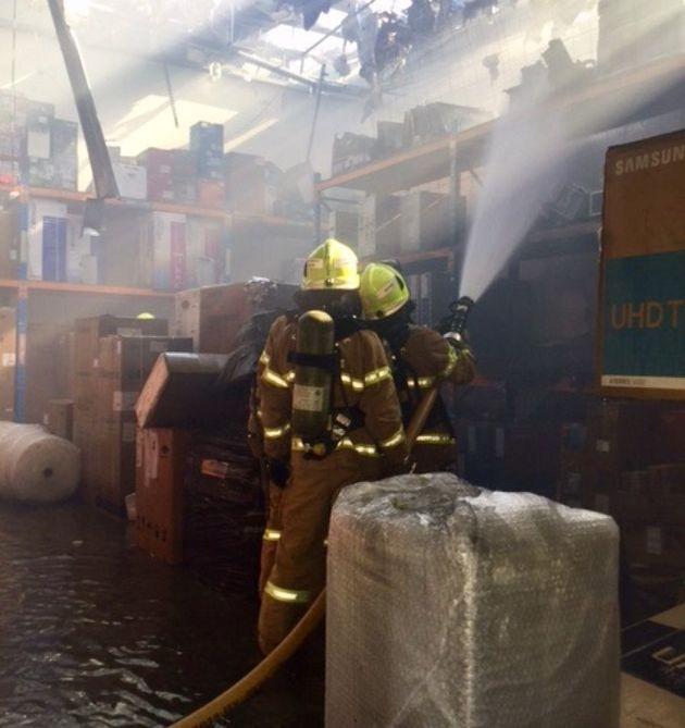 Firefighters battle the blaze inside a