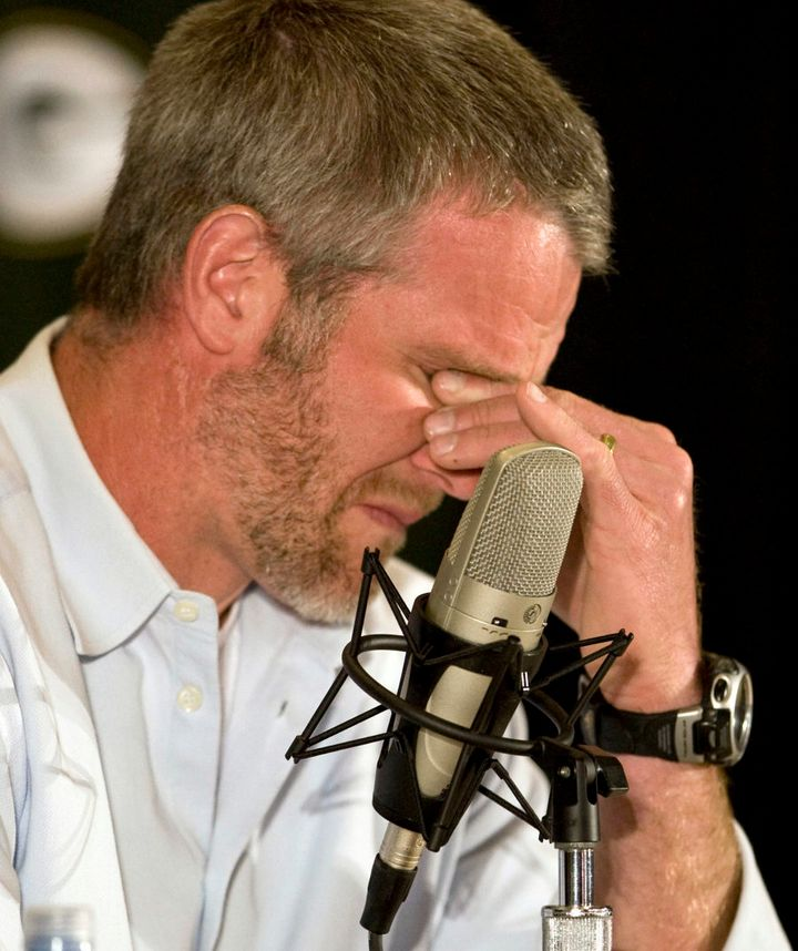 Brett Favre, the former Green Bay Packers' quarterback,  holds back the tears after announcing his retirement from the NFL after 17 seasons.