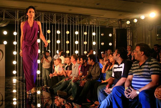 A familiar face or two watches a fashion show -- yes, a fashion show -- at an IPL after party. Because money.