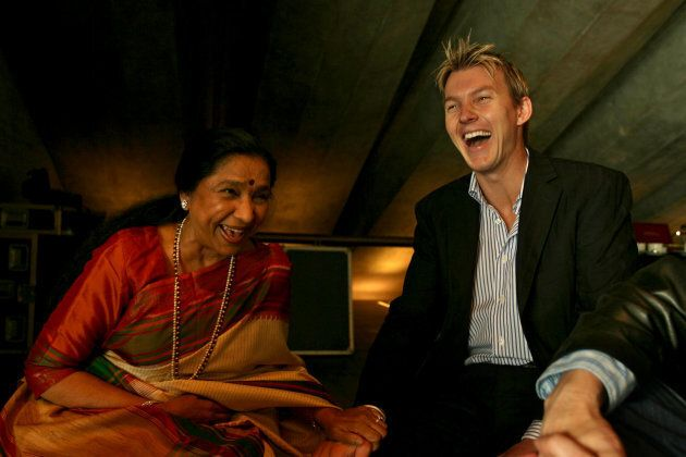 Bollywood singer Asha Bhosle plays the mother of Brett Lee's love interest in the video. She's laughing...