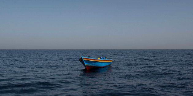 An empty wooden boat is left behind near Libya.