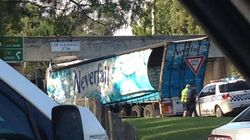 Neverfail Truck Gets Stuck Under A Bridge, It's Now Drowning In