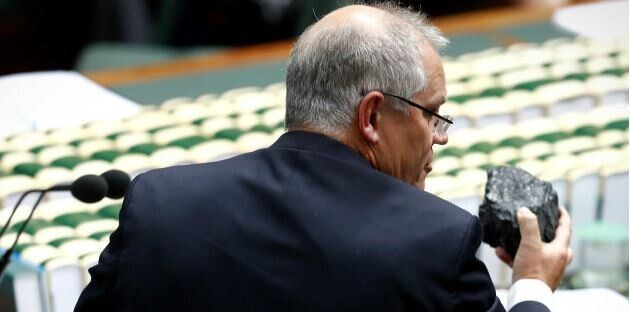 Federal Treasurer Scott Morrison brings a lump of coal to Question Time