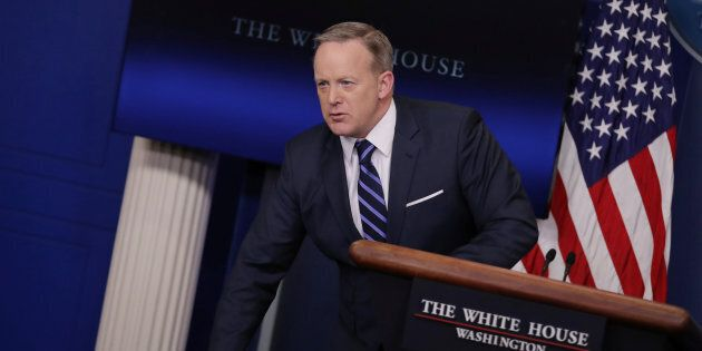 Sean Spicer with his piles of