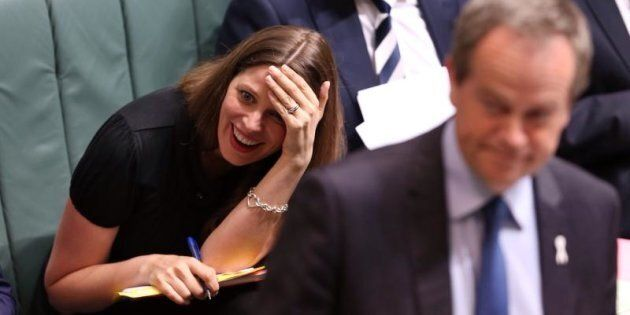 Kate Ellis reacts to an answer by Prime Minister Tony Abbott during question time at Parliament House...