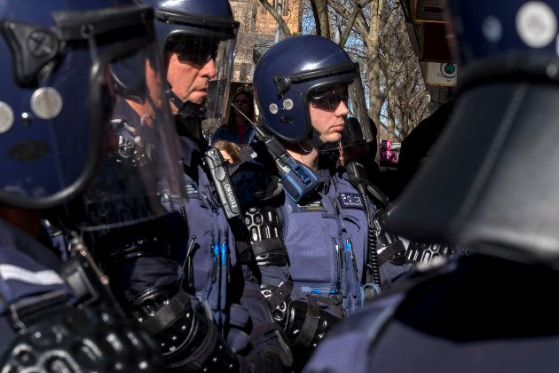Riot police are seen during a Black Lives Matter rally to protest in the wake of a spate of police shootings...