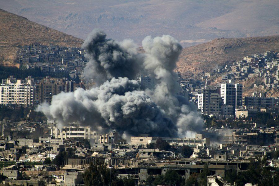 Smoke billows following reported air strikes by Syrian regime forces in the rebel-held area of Qabun,...
