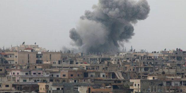 Smoke rises after strikes on rebel-held Deraa city, Syria.