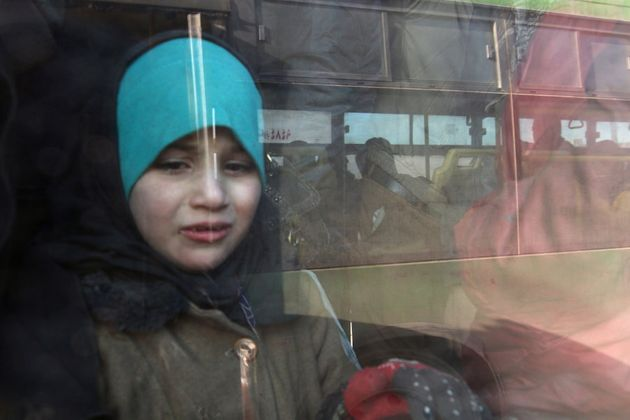 A girl rides a bus to be evacuated from a rebel-held sector of eastern Aleppo, Syria December 18,