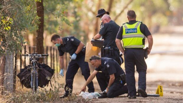Police search the Myrtleford-Everton Rail Trail where Kelvin Tennant was shot on 18