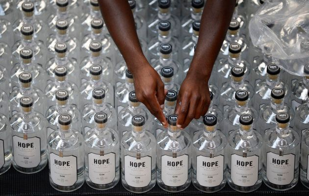 """Gin is enjoying a resurgence in South Africa, too. Here, a worker puts seals on bottles at the Hope on Hopkins distillery in Cape Town. """"Gin around the world is starting to have a moment and South Africa has jumped on the bandwagon,"""" said gin maker Lucy Beard. In 2015, her gin distillery was the first to be licensed in Cape Town, just as the drink began to make a stir."""