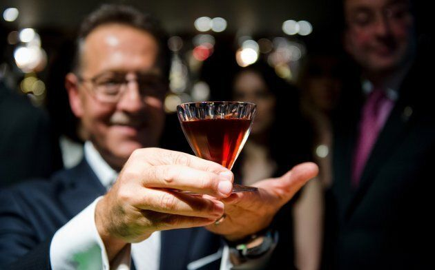 Salvatore Calabrese poses with a glass of his 'Salvatore's Legacy' cocktail, during an attempt to make the world's most expensive cocktail at 'Salvatore's Playboy Club' in London, England.
