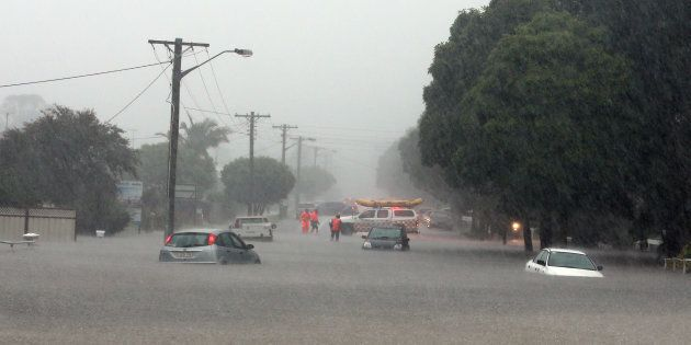 Cars caught in flood water in Albion Park