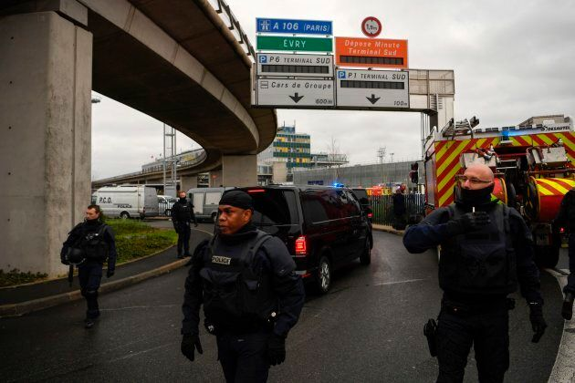 French Police unit (Raid) secure the area at Paris' Orly airport on March 18, 2017 following the shooting of a man by French security forces.Security forces at Paris' Orly airport shot dead a man who took a weapon from a soldier, the interior ministry said. Witnesses said the airport was evacuated following the shooting at around 8:30am (0730GMT). The man fled into a shop at the airport before he was shot dead, an interior ministry spokesman told AFP. He said there were no people were wounded in the incident. / AFP PHOTO / CHRISTOPHE SIMON        (Photo credit should read CHRISTOPHE SIMON/AFP/Getty Images)