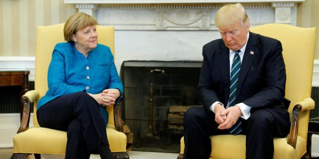 U.S. President Donald Trump and Germany's Chancellor Angela Merkel wait for reporters to enter the room before their meeting in the Oval Office at the White House in Washington.